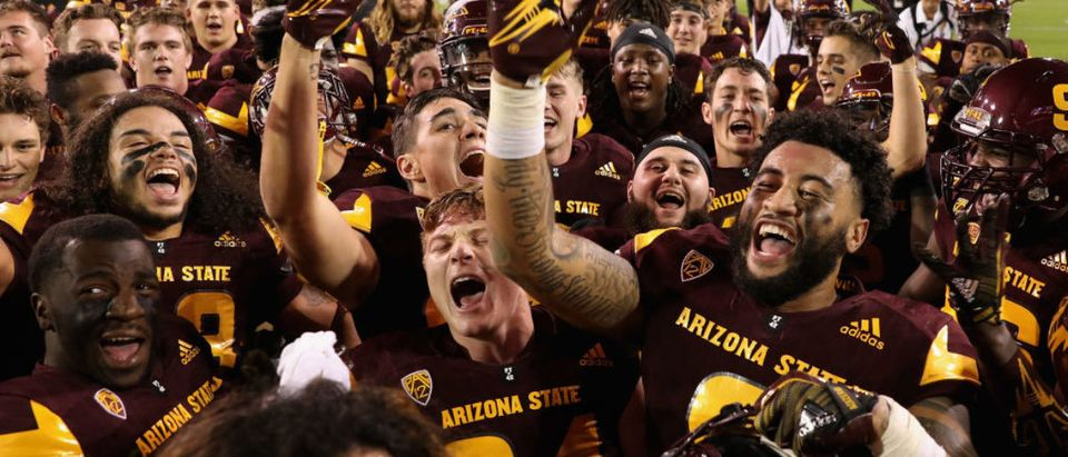 Tight end Jay Jay Wilson #9 (R) and the Arizona State Sun Devils celebrate after defeating the Oregon Ducks in the college football game at Sun Devil Stadium on September 23, 2017 in Tempe, Arizona. (Photo by Christian Petersen/Getty Images)