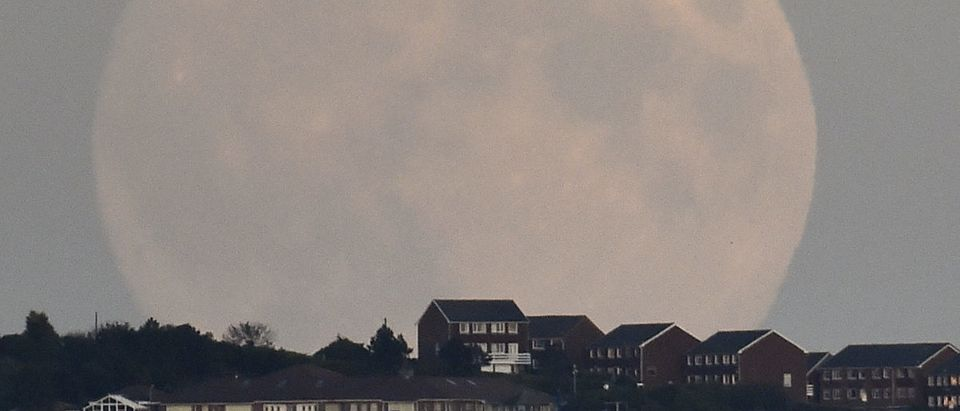 """A """"supermoon'' rises above Brighton in southern England"""