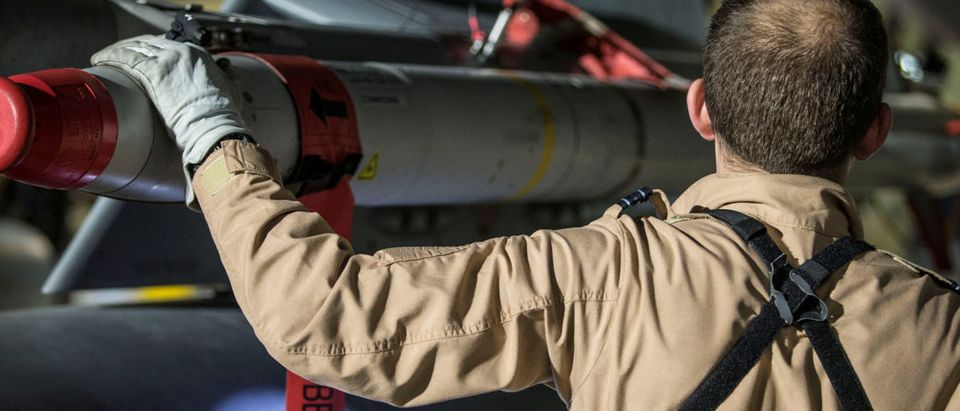 A Tornado pilot checks the weapons on his plane