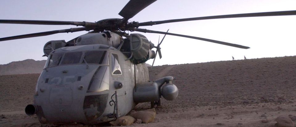 "A U.S. Marine Corps CH-53 Super Stallion sits idle after it had a ""hard landing"" northwest of the city of Kandahar, Afghanistan. [Marines are beginning the recovery process and hope to fly the damaged helicopter out of the rugged terrain and back to the Marine's base of operations at Kandahar International Airport. Picture taken December 30, 2001. REUTERS/Stringer"