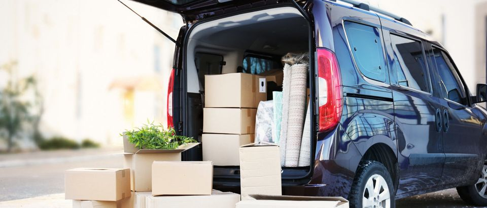 Boxes and packages packed away in a car. [Shutterstock - Africa Studio] | Amazon Wants Key To Your Car For Delivery