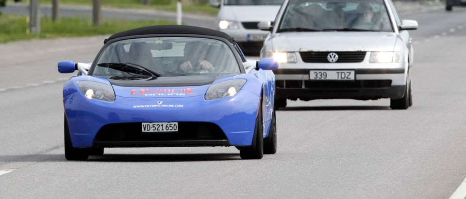 A Tesla Roadster runs on a road during an electric car rally in Tallinn