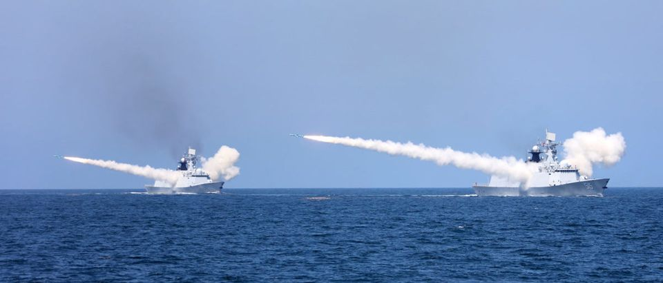 Chinese naval warships fire missiles during a live-fire military drill in the waters of Bohai Sea and Yellow Sea