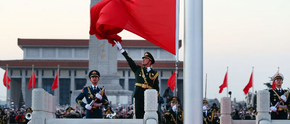 Members of Chinese People's Liberation Army (PLA) take part in the national flag-raising ceremony to mark the New Year on Tiananmen Square in Beijing
