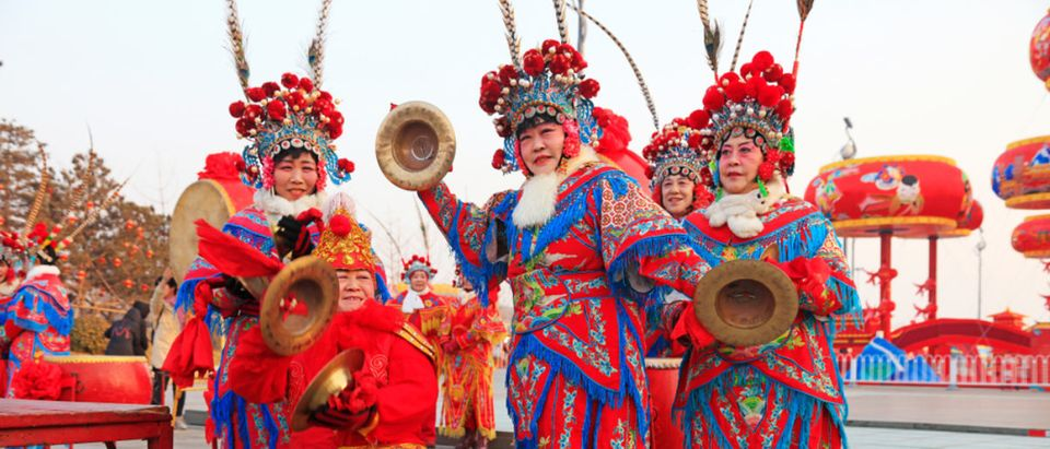 Tangshan City - February 20, 2018: percussion musicians dressed in Tang costume in parks, Tangshan City, Hebei, China (Shutterstock/Yuangeng Zhang)