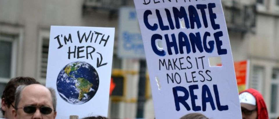 New York, New York. - April 22, 2017: People carrying signs as they participate in The March for Science in Manhattan in 2017 in New York City. (Christopher Penler / Shutterstock.com)