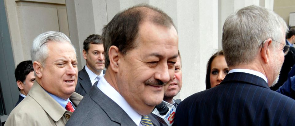 Former Massey Energy Chief Executive Don Blankenship smiles outside the Robert C. Byrd U.S. Courthouse in Charleston West Virginia