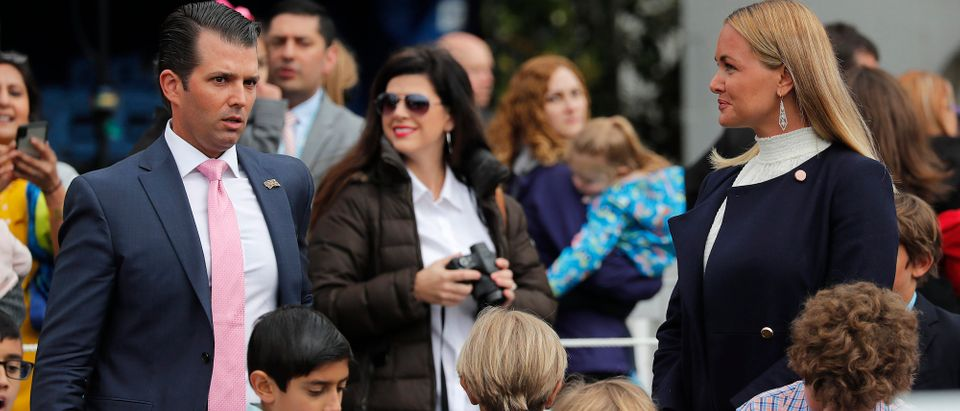 Donald Trump Jr. stands near his estranged wife Vanessa, who recently filed for divorce, as they attend the annual White House Easter Egg Roll with their children on the South Lawn of the White House in Washington, April 2, 2018. REUTERS/Carlos Barria