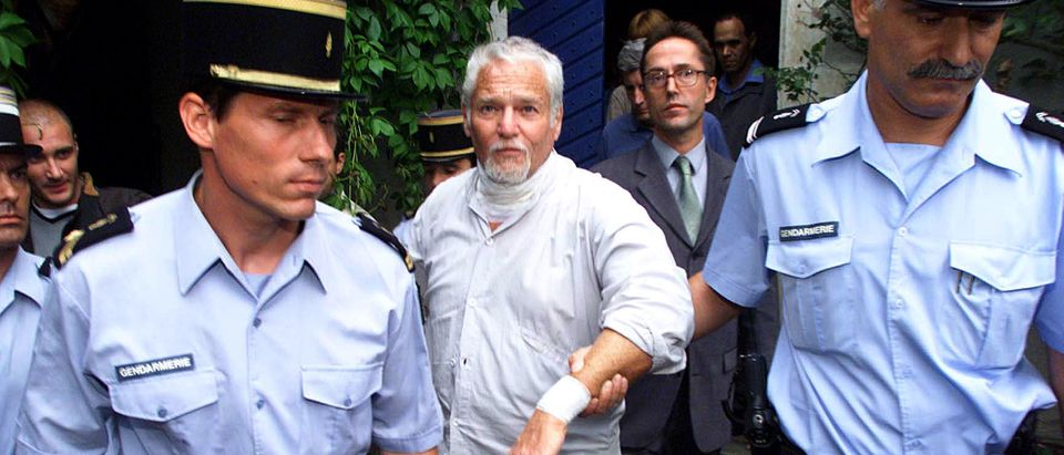 Fugitive former hippie guru Ira Einhorn (C) leaves his home under French gendarme escort in Champagne-Mouton, July 19, 2001, in a possible prelude to his extradition to the United States to face a new trial for the mirder of his girlfriend in 1977. The European Court of Human Rights earlier ruled that Einhorn could be extradited to the USA without further delay to be tried for murder. Einhorn, who slit open his throat in protest last Thursday after losing his final appeal against extradition from France to the U.S. for bludgeoning girlfriend Holly Maddux to death in 1977, promised to go quietly if French police carry out an order to extradite him th the U.S. to stand trial for murder. - Reuters | Earth Day Founder Killed His Girlfriend
