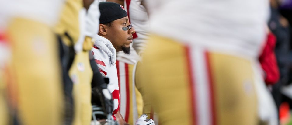 San Francisco 49ers defensive back Eric Reid (35) knees during the national anthem before the game against the Minnesota Vikings at U.S. Bank Stadium Aug 27, 2017. Photo: Brad Rempel-USA TODAY Sports