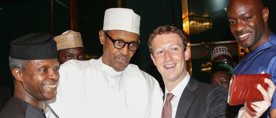 Abuja, on September 2, 2016. Nigerian President Muhammadu Buhari on September 2 praised Facebook founder Mark Zuckerberg for inspiring young entrepreneurs during his surprise visit to the west African country this week, his office said. Zuckerberg who arrived in Nigeria on Tuesday and has met with young entrepreneurs at information technology and computer centres in the country's commercial hub of Lagos and the capital Abuja. (Photo: SUNDAY AGHAEZE/AFP/Getty Images)