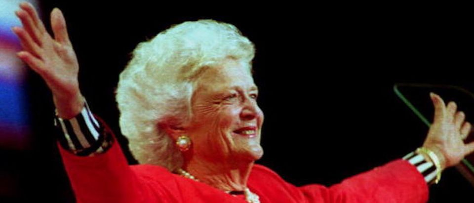 """HOUSTON, TX - AUGUST 19: First Lady Barbara Bush greets the delegates attending the 1992 Republican Convention before beginning her 19 August 1992 speech. The First Lady said she was making a case for the re-election of """"the strongest , the most decent, most caring, wisest and yes, the healthiest man I know."""" (Photo credit should read BOB DAEMMRICH/AFP/Getty Images) 