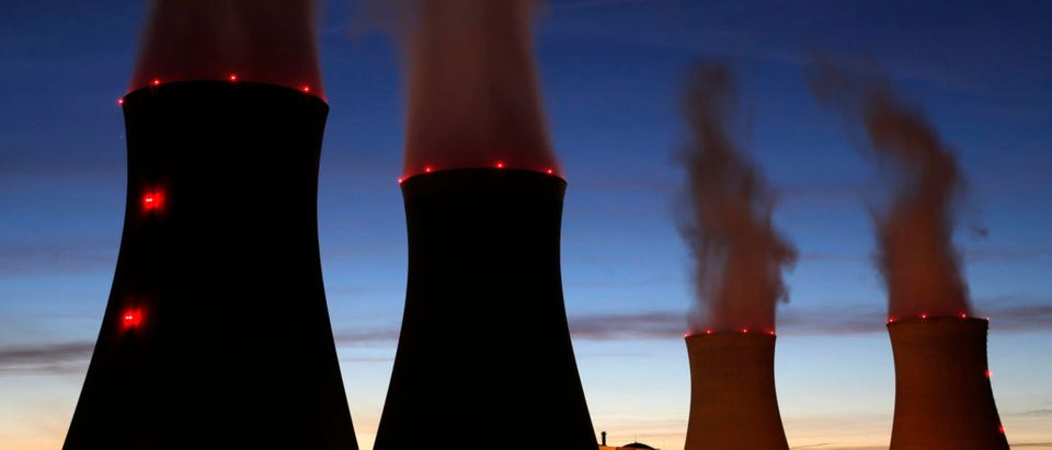 Steam rises at night from the cooling towers of the Electricite de France (EDF) nuclear power station in Dampierre-en-Burly, March 8, 2015. The future of France's nuclear industry has never looked bleaker, with a government pledging to wean the country off atomic power, cut-throat rivalry in world export markets and the debt of flagship nuclear group Areva mired deep in junk territory. Picture taken March 8, 2015. REUTERS/Christian Hartmann | FirstEnergy To Close Nuclear Plants
