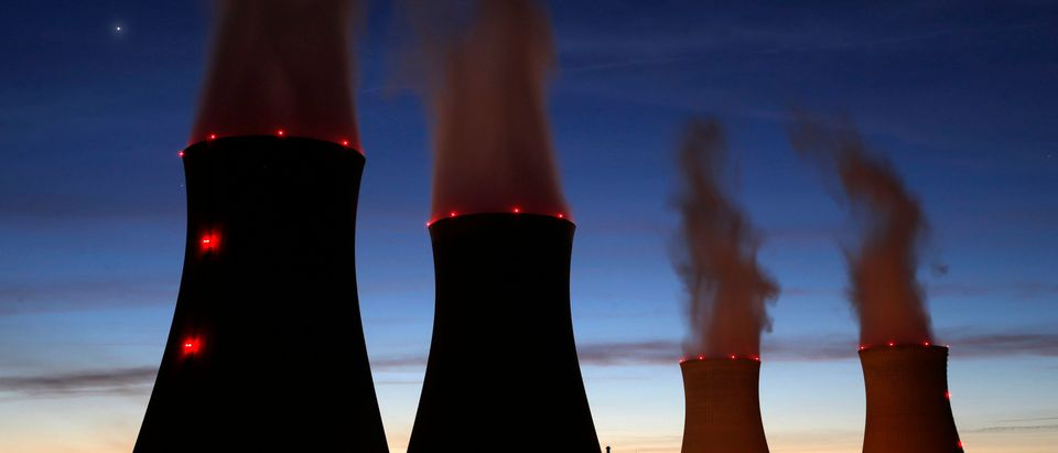 Steam rises at night from the cooling towers of the Electricite de France (EDF) nuclear power station in Dampierre-en-Burly, March 8, 2015. Picture taken March 8, 2015. REUTERS/Christian Hartmann | Nuclear Company Wants Help From Trump