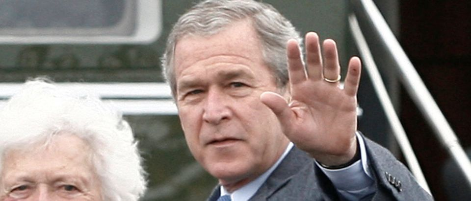 FILE PHOTO: U.S. President Bush and his parents wave upon their arrival for Easter Service in Fort Hood, Texas