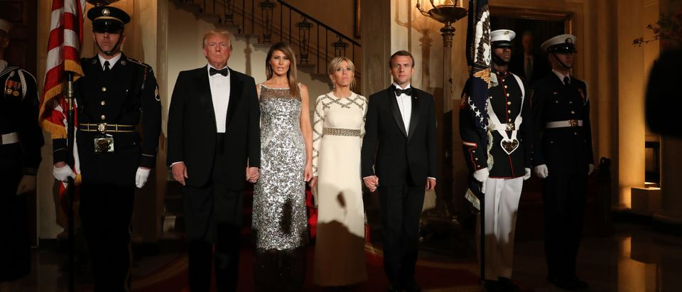 US President Donald Trump and First Lady Melania Trump stand with French President Emmanuel Macron and his wife, Brigitte Macron at the start of a State Dinner in the White House in Washington, D.C., April 24, 2018. (Photo: LUDOVIC MARIN/AFP/Getty Images)
