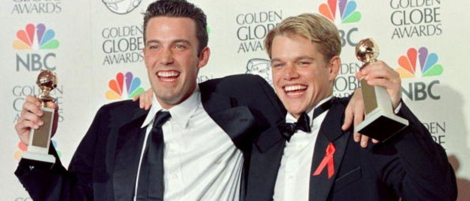 Actor Matt Damon (R) and co-writer Ben Affleck (L)