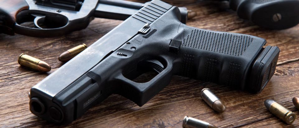 A 5-year-old Missouri boy accidentally shot his older brother with a gun while looking for candy in his house, according to the family. (Photo: Guns/Kiattipong/Shutterstock)