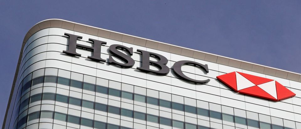 The HSBC bank logo is seen at their offices in the Canary Wharf financial district in London