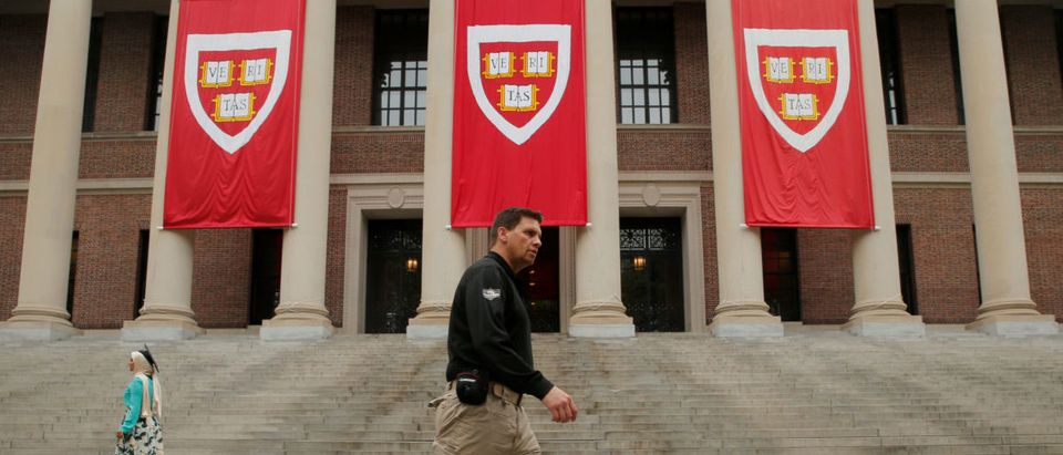 A security guard and an explosives sniffing dog check Tercentenary Theatre before former U.S. Vice President Joe Biden speaks at Class Day at Harvard University in Cambridge