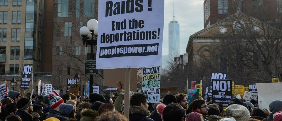 People participate in a protest against U.S. President Donald Trump's immigration policy and the recent Immigration and Customs Enforcement (ICE) raids in New York City