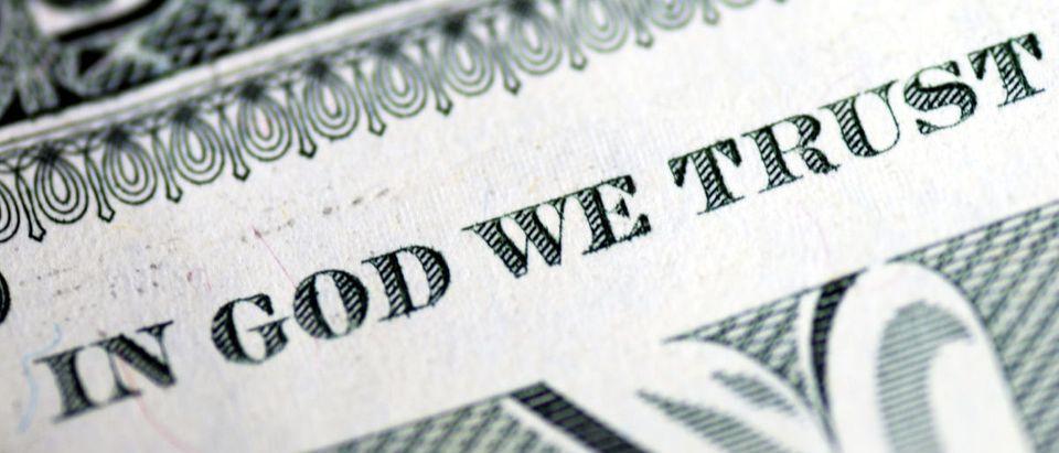 In God We Trust from the dollar bill - ShutterStock - John Kwan
