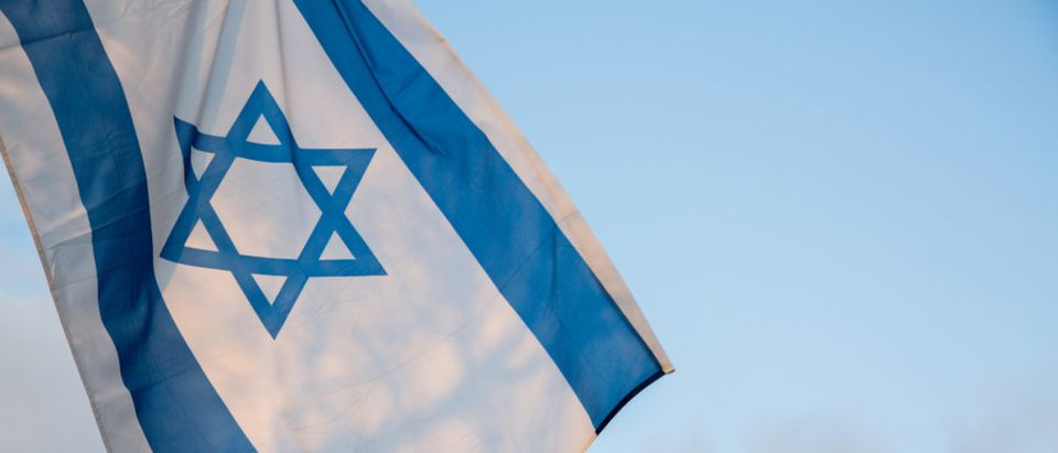 Here's the Israel flag waving on the blue sky background. (Shutterstock/Shai Daniel)
