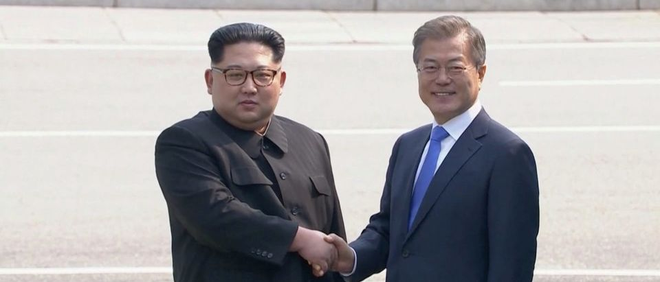 North Korean leader Kim Jong Un shakes hands with South Korean President Moon Jae-in as both of them arrive for the inter-Korean summit at the truce village of Panmunjom, in this still frame taken from video, South Korea April 27, 2018. Host Broadcaster via REUTERS TV
