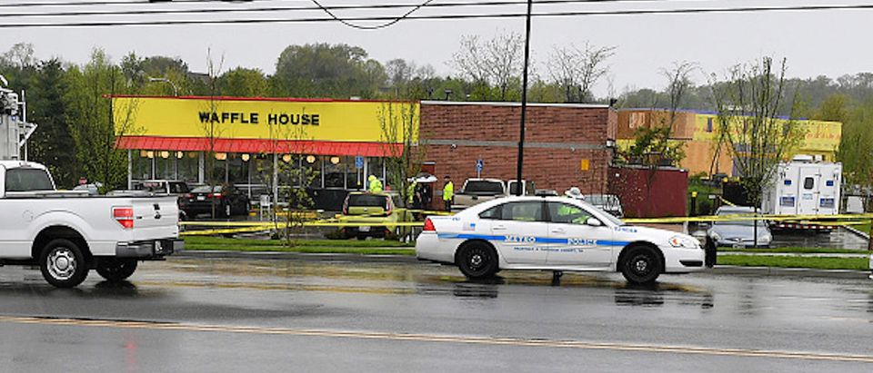 NASHVILLE, TN - APRIL 22: Law enforcement investigate the scene outside a Waffle House where four people were killed and two were wounded after a gunman opened fire with an assault weapon on April 22, 2018 in Nashville, Tennessee. Travis Reinking, 29, of Morton, IL, is person of interest in the shooting and is suspected to have left the scene naked. (Photo by Jason Davis/Getty Images) | Hero Saved Lives Waffle House Shooting