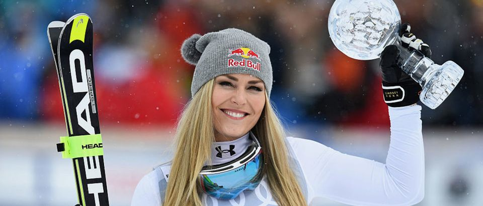 Lindsey Vonn of the USA poses with the Women's World Cup Downhill Crystal Globe trophy after the Women's Downhill Race on March 16, 2016 in St Moritz, Switzerland. (Photo by Matthias Hangst/Getty Images)