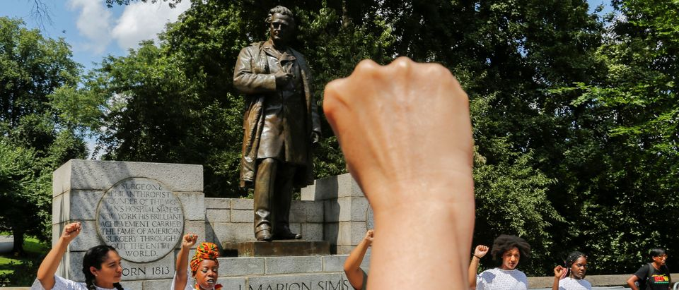 People take part in protest against white supremacy in front of J. Marion Sims statue in New York