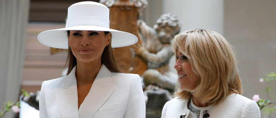 WASHINGTON, D.C. - April 24: First lady Melania Trump and French first lady Brigitte Macron tour the National Gallery of Art on April 24, 2018 in Washington, DC. President Donald Trump is hosting French President Emmanuel Macron for the first state visit of his presidency. (Photo by Aaron P. Bernstein/Getty Images)