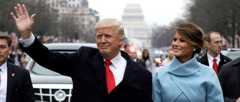U.S. President Donald Trump waves to supporters as he walks the parade route with first lady Melania Trump after being sworn in at the 58th Presidential Inauguration January 20, 2017 in Washington, D.C. Donald J. Trump was sworn in today as the 45th president of the United States (Photo by Evan Vucci - Pool/Getty Images)