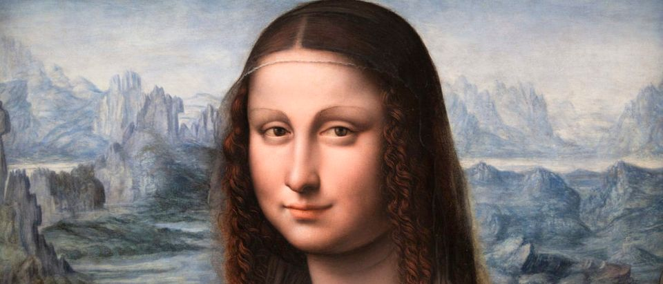 "A copy of Leonardo Da Vinci's famous ""Mona Lisa"" painting from Madrid's El Prado Museum is displayed during a press presentation at the Louvre museum in Paris"