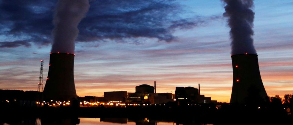 Cooling towers at the Golfech nuclear plant are pictured during sunset on the edge of the Garonne river between Agen and Toulouse