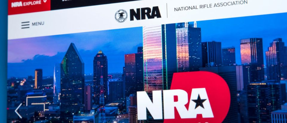 LONDON, UK - FEBRUARY 22ND 2018: The homepage of the official website for the National Rifle Association - the NRA is a US nonprofit organization that advocates for gun rights, on 22nd February 2018. (Shutterstok/chrisdorney) | Prof Charged For Vandalizing NRA House