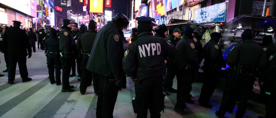 New York Police Department (NYPD) officers stand in Times Square ahead of the New Year's Eve celebrations in Manhattan, New York, U.S., December 31, 2017. REUTERS/Amr Alfiky