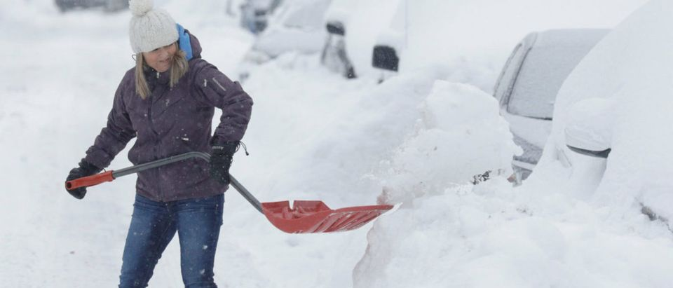 Line Dessureault shovels snow away from her car that was buried in snow as a late winter storm that dumped more than two feet (60 cm) of snow in certain areas of Quebec, closed schools and some roadways causing multiple highway collisions and incidents of trapped motorists, in Montreal, Quebec, Canada March 15, 2017. REUTERS/Dario Ayala | New Hampshire Aims To Lower Energy Costs
