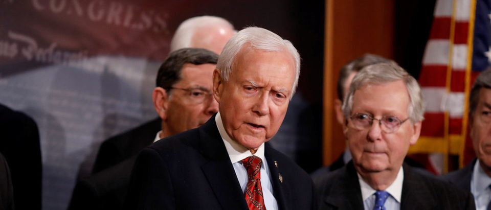 Sen. Orrin Hatch (R-UT), accompanied by Senate Majority Leader Mitch McConnell and members of the Republican Conference, speaks at a news conference about the passage of the Tax Cuts and Jobs Acts at the U.S. Capitol in Washington, U.S., December 20, 2017. REUTERS/Aaron P. Bernstein