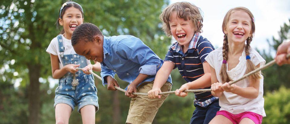 Children playing tug of war at the park Shutterstock/ Robert Kneschke | 'Free-Range Parenting' Law Passed In Utah
