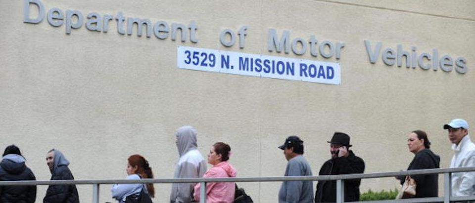 People wait in line outside of the State of California Department of Motor Vehicles (DMV) in Los Angeles, California on February 13, 2009. ROBYN BECK/AFP/Getty Images