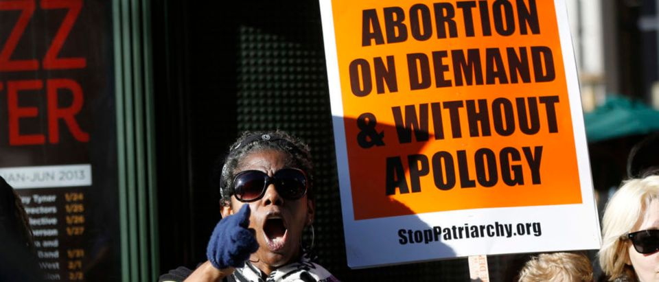 A pro-choice demonstrator shouts during a counter demonstration at the Ninth Annual Walk for Life West Coast in San Francisco, California, January 26, 2013. Hundreds of pro-life demonstrators marched in San Francisco to mark the 40th anniversary of Roe v. Wade U.S. Supreme Court decision legalizing abortion. REUTERS/Stephen Lam | Abortion Bill Passes In Landslide Vote