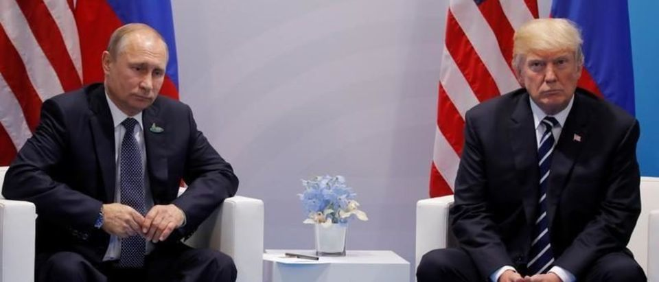 FILE PHOTO:U.S. President Donald Trump meets with Russian President Vladimir Putin during their bilateral meeting at the G20 summit in Hamburg
