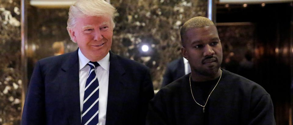 U.S. President-elect Donald Trump and musician Kanye West pose for media at Trump Tower in Manhattan, New York City