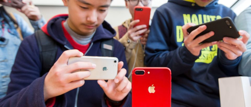 Customers visit an Apple store in Nanjing