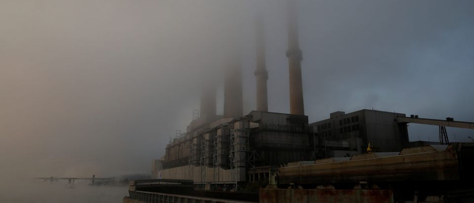 Fog covers the W. H. Sammis Power Plant, a coal-fired power-plant owned by FirstEnergy, along the Ohio River in Stratton