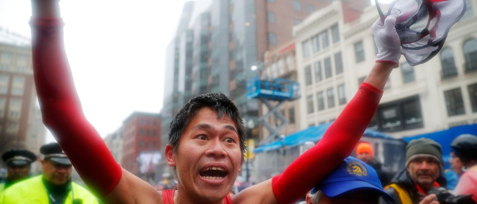 Yuki Kawauchi of Japan celebrates after winning the men's division of the 122nd Boston Marathon April 16, 2018. REUTERS/Brian Snyder