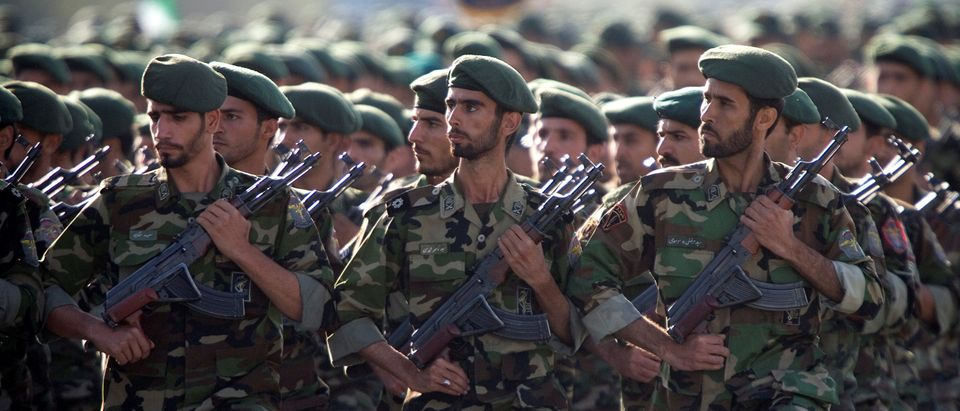 Members of Iran's Revolutionary Guards march during a military parade to commemorate the 1980-88 Iran-Iraq war in Tehran