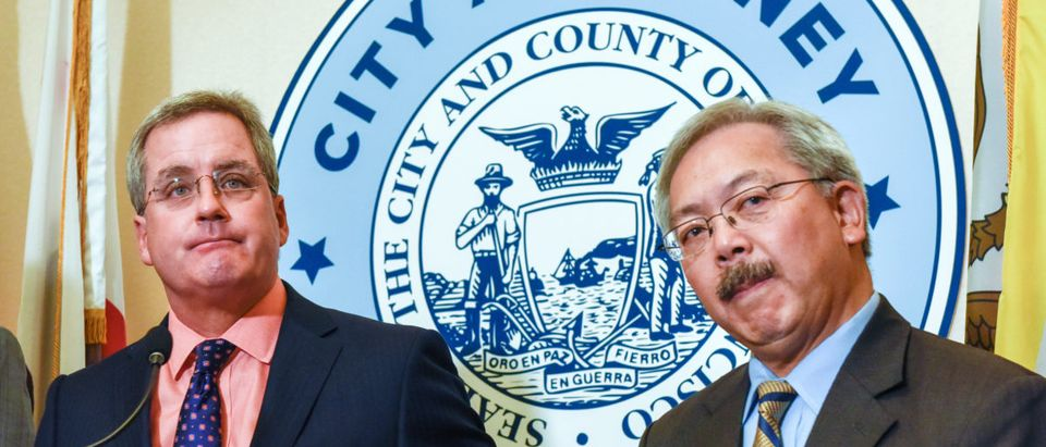 San Francisco City Attorney Dennis Herrera (L) and Mayor Ed Lee during a news conference where they announced the filing of a federal lawsuit against President Donald Trump and his administration at City Hall in San Francisco, California, U.S., January 31, 2017. REUTERS/Kate Munsch