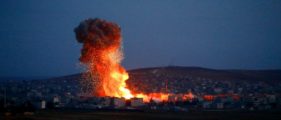 Smoke and flames rise over Syrian town of Kobani after an airstrike, as seen from the Mursitpinar border crossing on the Turkish-Syrian border in the southeastern town of Suruc in Sanliurfa province, October 18, 2014. REUTERS/Kai Pfaffenbach